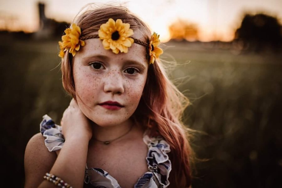 Portrait of girl with freckles wearing sunflower crown, Beyond the Wanderlust Daily Fan Favorite
