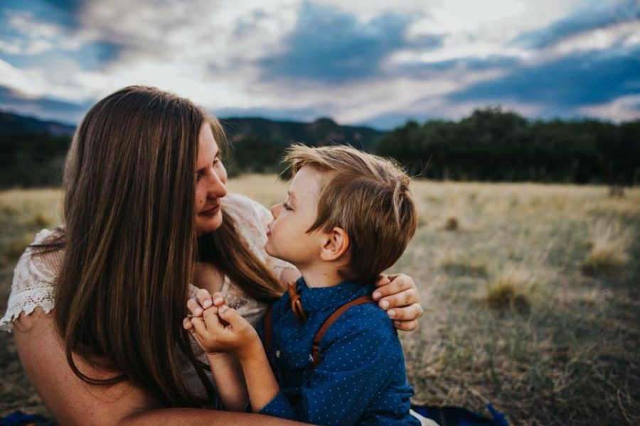 Mother and son in field looking at each other, Beyond the Wanderlust Daily Fan Favorite