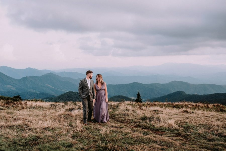 Couple walking together with mountains in distance, Beyond the Wanderlust Daily Fan Favorite
