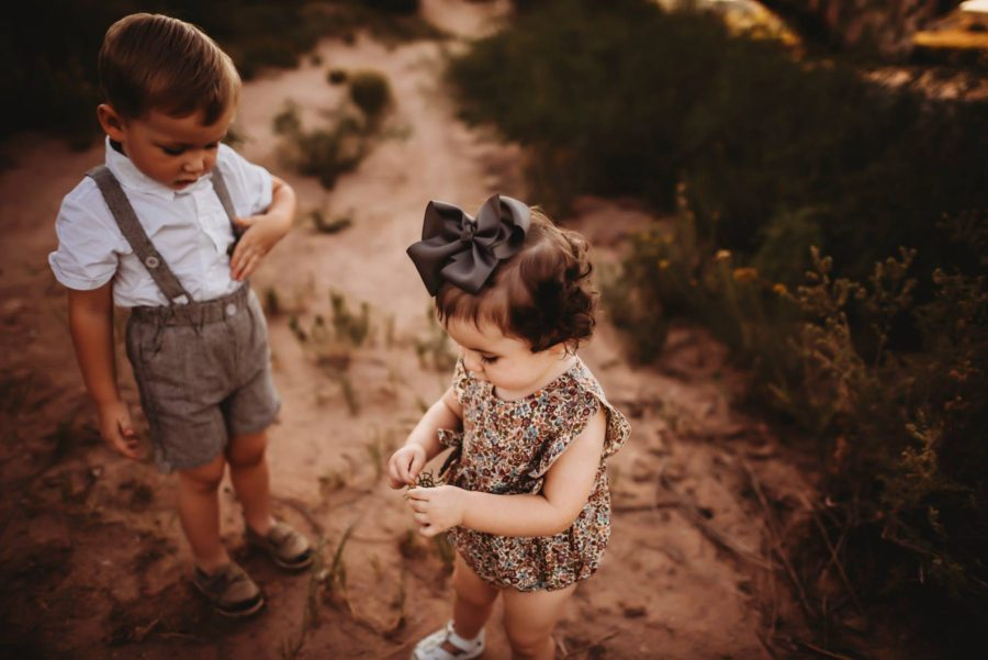 Toddlers standing in sandy field exploring, Beyond the Wanderlust Daily Fan Favorite