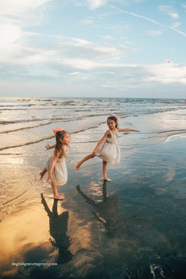 Girls standing on ocean shore doing ballet, Beyond the Wanderlust Daily Fan Favorites