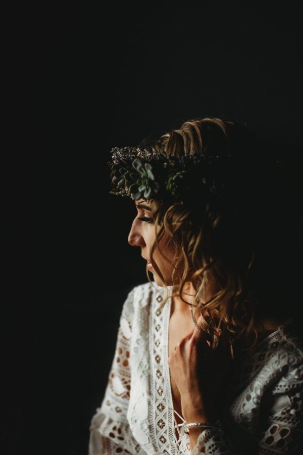 Side lit portrait of woman with black background, Beyond the Wanderlust Daily Fan Favorites