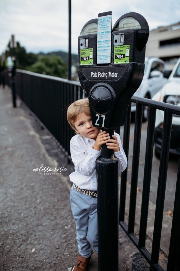 Boy peeking out from behind parking meter, Beyond the Wanderlust Daily Fan Favorite