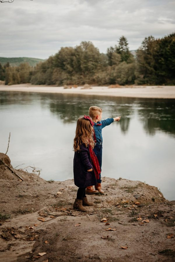 Kids standing on dirt river bank pointing across, Sweet E Photography Daily Fan Favorite