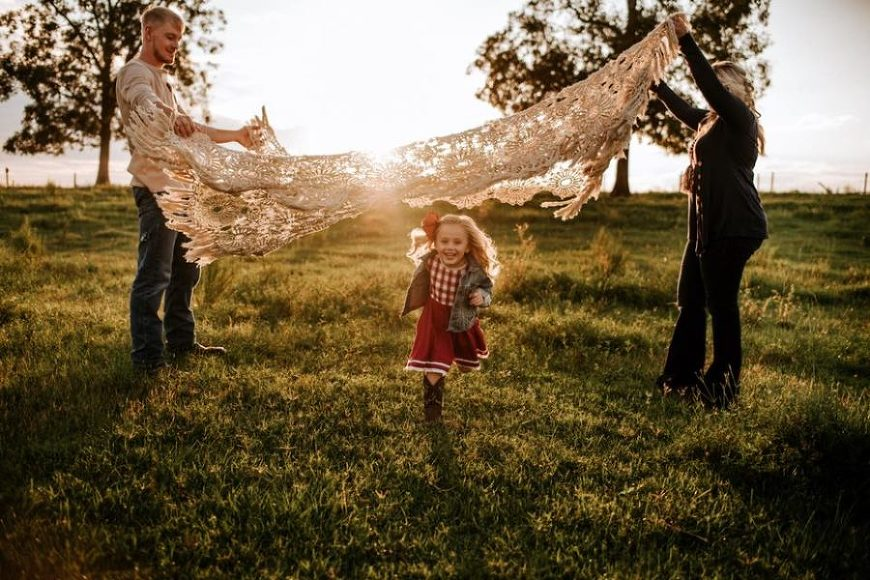 Girl running under blanket as man and woman hold it up, Beyond the Wanderlust Daily Fan Favorites