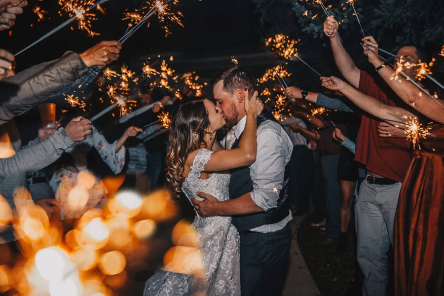 12.Bride and Groom kissing under sparklers, Beyond the Wanderlust Daily Fan Favorites