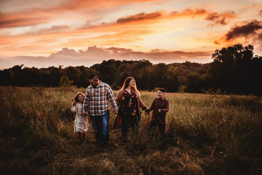 Family holding hands walking together in field at sunset, Maverick Organic Art Co. Daily Fan Favorite