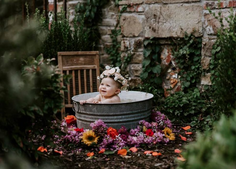 Baby with flower crown sittin gin tin bucket outside, Beyond the Wanderlust Daily Fan Favorites