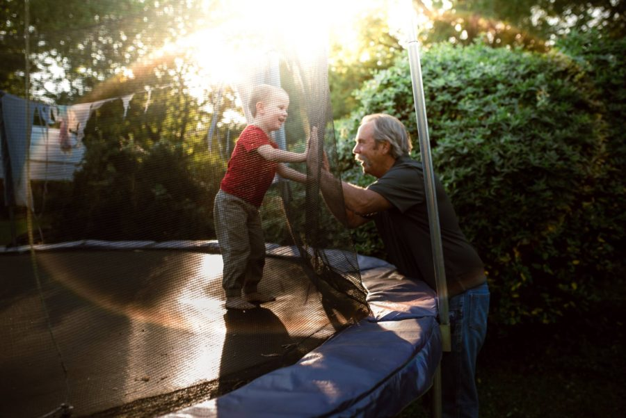 lifestyle pictures, grandson playing with grandfather, documentary pictures