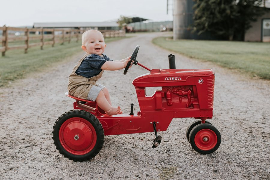 First birthday pictures, little kid on farm, little boy riding red tractor