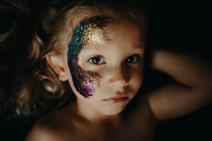 girl with rainbow face paint, little girl, indoor lifestyle children pictures